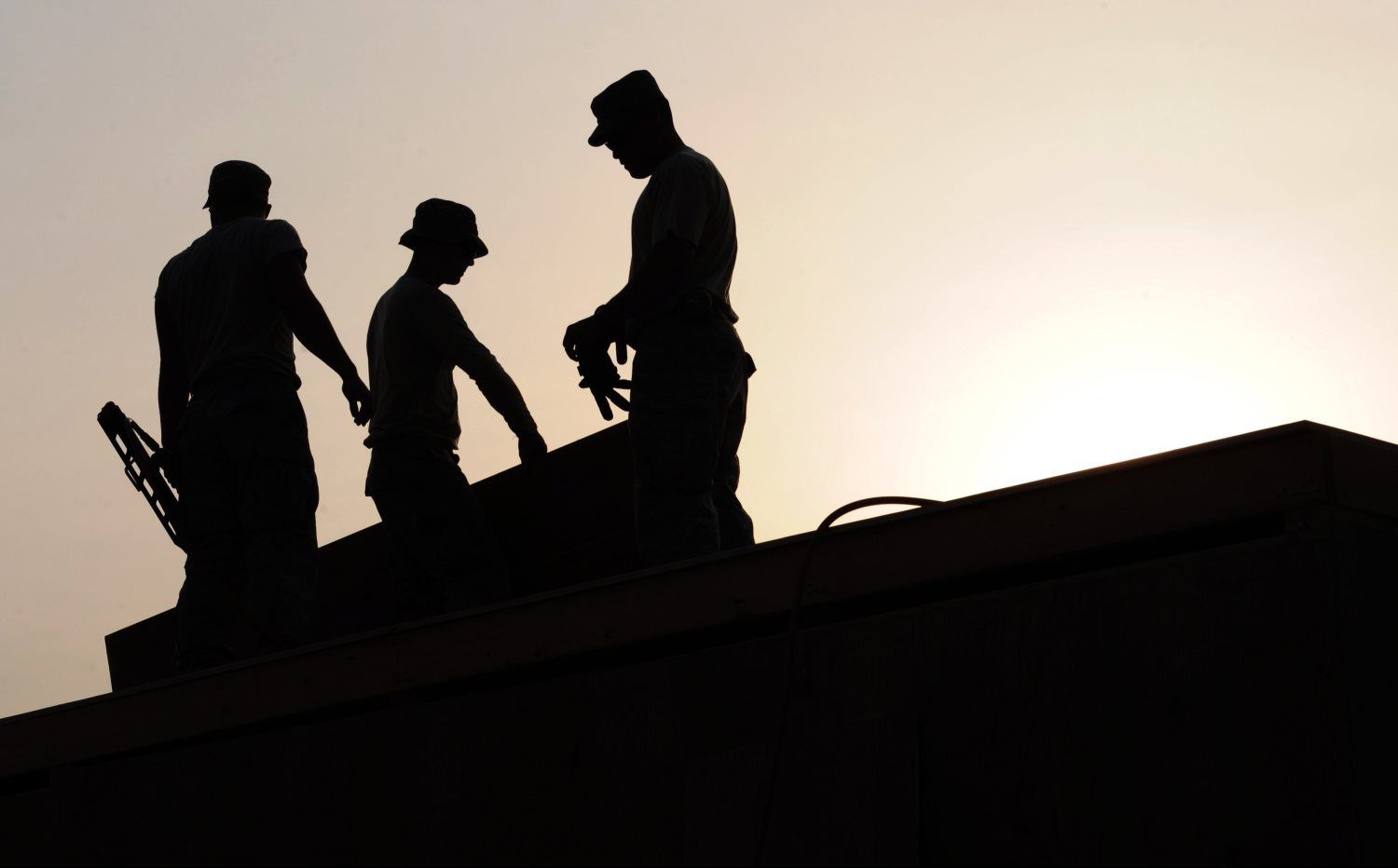 workers-construction-site-hardhats