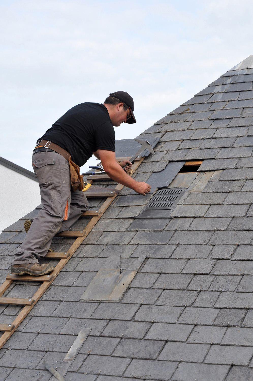 roofer repairing roof in wisconsin