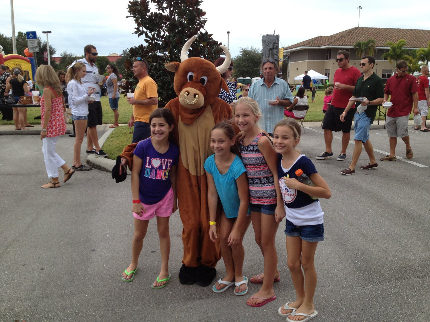 kids taking photo with a mascot